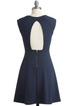I adore everything about this dress: The color, the fabric, and the zipper in the back, but the best part is definitely the cutout in the back. The front is very simple, and the back is what gives it something so special!