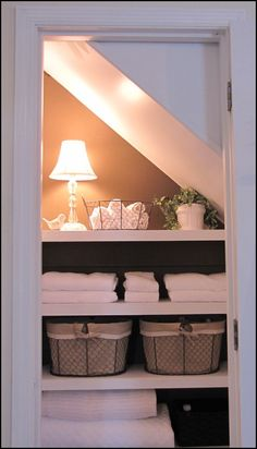 Idea for tucking in Storage, like a linen closet, below the awkward stair space. | From: Beneath My Heart. on the back of the door hooks fpr hanging the ironing board. great use of space