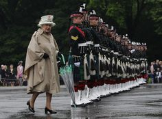 Britain's Queen Elizabeth walks past soldiers from the Royal Regiment of Scotland, during the Ceremony Of The Keys at Holyrood Palace in Edinburgh, Scotland. (Reuters)