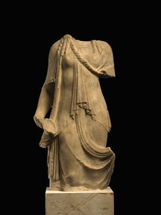 Naked male kouroi (youths) were sculpted as an emblem of physical and moral excellence. A female counterpart was known as a kore (girl). Although clothed, the forms of the body were often carefully indicated beneath the layers of sculpted fabric. Originally, this girl held a bowl in her right hand and a fold of her skirt in the left.