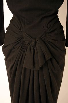 Dress, Dinner.  Elsa Schiaparelli  (Italian, 1890–1973).  Date: ca. 1938. Culture: French. Medium: wool, porcelain, metal. Dimensions: Length at CB: 55 in. (139.7 cm).