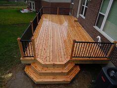 This is a 14 x 30 cedar deck, with a small bumpout that spills over into custom cascading steps. 440 square feet of space, including steps. We also installed black American Aluminum railing. Deck Steps, Cedar Deck, Front Deck, New Deck, Backyard Patio Designs, Deck Railings, Deck Railing Design, Deck Plans, Decks And Porches