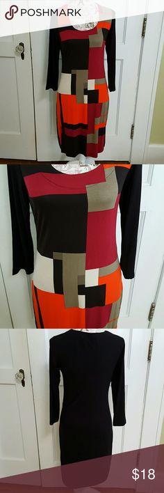 "Venus Dress Front Color Blocked of Orange, Black, Burgandy, Gray, & Cream.   Back is Solid Black.  Scoop Neck. 3/4 Sleeves.    37"" Length.   Machine Washable.   95% Viscose  5% Elastane Venus Dresses"
