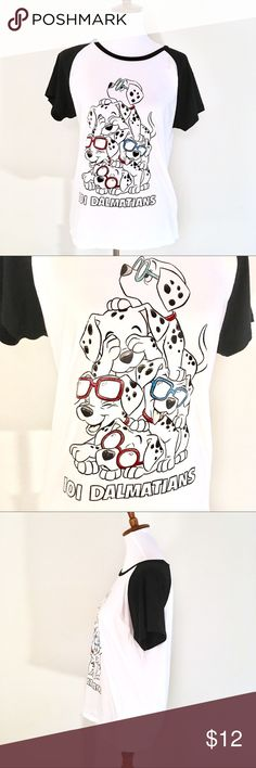 "Disney 101 Dalmatians Graphic Tee Cotton T-Shirt Adorable Disney's 101 Dalmatians graphic tee! 100% Cotton. Excellent condition!  Tag says it is a size L, but it fits more like a size M in my opinion. pit to pit: 18.5"" top to bottom: 24"" Disney Tops Tees - Short Sleeve"