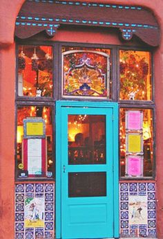 Cafe Pasqual's Santa Fe, NM. I just love quirky, colorful, New Mexico designs like this!