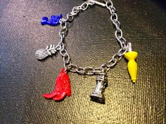 HIMYM charm bracelet Etsy listing at https://www.etsy.com/listing/184892687/how-i-met-your-mother-inspired-charm