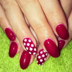 Red glitter gel nails with gelaze gel polish in ruby pumps and white polka dots.