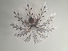 .semi-mount adding sparkle to the foyer/ Fine Arts