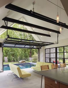 love this | there's a garage door that opens to give fresh air and heat and if it's closed there is lots of natural light with all those windows! :)