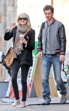 Oh hey Emma Stone! The smiley blonde beauty, in demure cat-eye shades, waved to the camera while hangin' with beau Andrew Garfield! He really should be wearing sunnies…