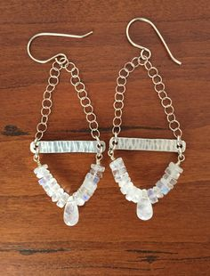 Moonstone earrings. These lovely, elegant long earrings feature moonstone. Watch some of the pieces glow with blue luminescence as they catch the