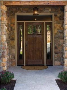 The look and combination is really outstanding and Rustic look because of door style, and the stone entrance, in addition the transom and the door color would make the look more Rustic Style.