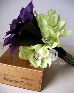 Introducing Mystic Plum. A wedding bouquet of deep plum purple calla lilies and lime green cymbidium orchids. Stems are wrapped with two-tone purple ribbon and can be embellished. www.bloomedtolast.com | Wedding Planning | Bloomed To Last | purple bouquet | bridal bouquet | wedding flowers | wedding bouquet