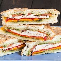 Turkey Pesto Panini filled with roasted red peppers, cheddar cheese, tomatoes, and turkey | jocooks
