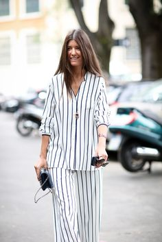 Awning stripes on a pajama set look great when matched with a '70s-inspired approach to beauty. #refinery29 http://www.refinery29.com/2014/09/74945/milan-fashion-week-2014-street-style#slide-20