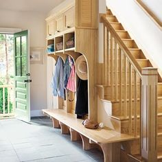 These curvaceous cubbies mounted alongside the stairs turns a front foyer into a mini mudroom.