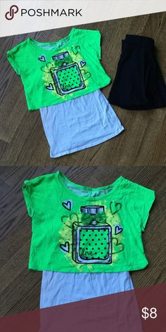 Girls Justice top 2 piece Girls 2 piece Justice top size 10. The white tank is attached underneath the green shirt. Justice Shirts & Tops