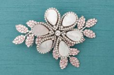 Six petal Mother of Pearl/Crystal Comb #58618$575