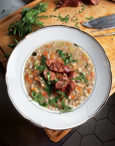Classic German barley soup makes a hearty, substantial meal; to make it vegetarian, simply omit the sausage and bacon.