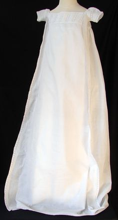 """Circa 1810, Fine Empire Christening Gown  Measuring apprx. 44"""" long, 10 1/2"""" across chestline, almost 4"""" across armhole. In mainly very good condition, there are some repairs, very minor on a early dress like this."""