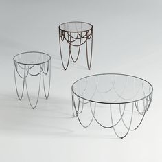 Drapery Nathan Young 2011 Two occasional round tables, different in diameter and height.