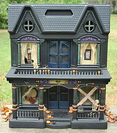 easy halloween decoration to make, crafts, halloween decorations, seasonal holiday decor, I saw this idea in an old issue of Country Living I thought it was so clever You just spray paint an old doll house black and turn it into a haunted house Halloween Decorations To Make, Halloween Village, Halloween Doll, Homemade Halloween, Holidays Halloween, Halloween Crafts, Halloween Ideas, Spooky Halloween, Halloween Stuff