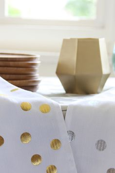 Dandi's woven herringbone tea towels are super absorbent. Add a touch of metallic glamour to your home. Sold individually and available in both silver and gold metallic foil confetti print, to make them even more special we've added metallic fleck tassels to each tea towel making them the perfect gift to give.   http://www.dandi.com.au/kitchen/tea-towels/confetti-spot-tea-towel-gold