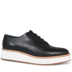 Crafted from supple black leather, these platforms are some serious urban edge. Combining the support and white sole silhouette of a sneaker with the clean leather lace up upper of a brogue, Milas are a style stand out for any winter wardrobe.  Leather