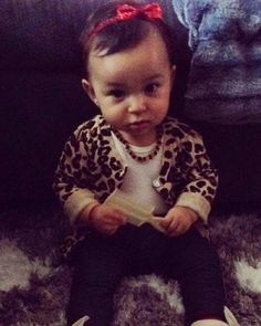 Leopard sweater, white shirt, leggings, ivory mocossains, red bow