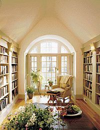 Narrow room with built-in bookcases spanning both sides. Beautiful!