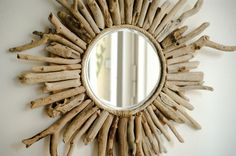 Beautiful, decorative mirror, sunburst beach cottage style, made of driftwood .... This lovely mirror will bring a warm, summer atmosphere into your home. This mirror would look great with a rustic style of decor, as well as a modern, clean environment that needs an earthy touch. The wood itself is not treated (wax or varnish) at all. We wanted to keep its natural, typical driftwood feeling and touch. Frame Dimension: approx 14 (35cm) Mirror Dimension: 4.8 (12cm) The mirror will ...