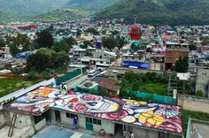 Ecatepec, MexicoMurals by artist Israel Zuniga painted appear on the roofs of buildings on the route of a new cable car that will run this year