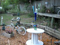 """My version of a bottle tree. It's """"growing"""" in my artsy garden."""