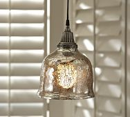 mercury glass pendant over island in kitchen. Unfortunately, I have searched and searched for this pendant and can not find.