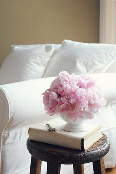 beautiful peonies + comfy reading chair makes me want to reach for a little flaubert