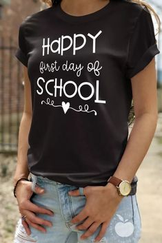"Celebrate the first day with this ""Happy First Day of School"" teacher tee. This is the perfect shirt for the first day of school because it's both cute and comfortable. Whether you're a teacher, principal, or other school support staff member, you'll love this t-shirt and want to wear it on the first day each year. #firstdayofschool #teachertee #1stdayofschool #teachershirt"