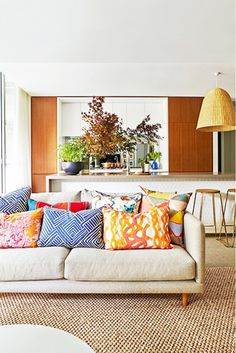 Colorful, patterned pillows add fun to neutral spaces.