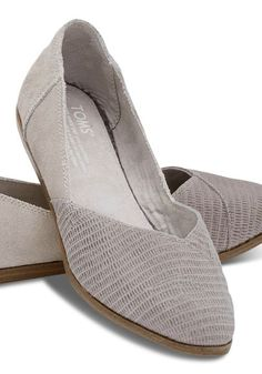 These pointed flats feature a beautiful asymmetrical design and offer both suede and embossed panels for an added style boost.