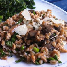 My Meatless Monday Dinner - chilled farro and roasted cremini mushroom salad with chopped garlic scapes, chives, basil, parsley, lemon juice, xtra vrgn olive oil, shaved parmesan with a side of braised kale.