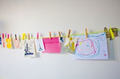A great way to hang kids art, and let them arrange and re-arrange as they please.