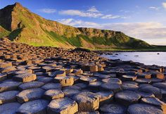 The Giant's Causeway, Northern Ireland... It is a vast a field of thousands and thousands of basalt columns formed by ancient volcanic activity.