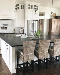 White cabinets. Black countertops (id love a butcher block island) & cabinets that reach to the ceiling!