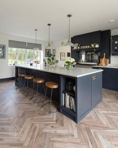 This classic Shaker kitchen is hand painted in After Midnight, our most popular dark grey colour. The large kitchen island can accommodate up to four bar stools, an ideal spot for informal dining. For more kitchen inspiration check out our website. Large Open Plan Kitchens, Open Plan Kitchen Diner, Large Kitchen Island, Kitchen Layout, Kitchen Islands, Small Kitchens, Farmhouse Kitchen Island, Kitchen Island On Wheels, Small Space Kitchen