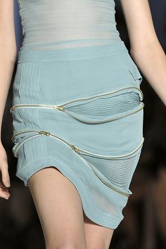 Skirt with stitched patterns & decorative zipper detail revealing pleated fabric inserts - fabric manipulation; creative garment construction // Preen SS09