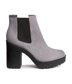 Platform boots with elasticized side panels and chunky rubber soles. Front platform height 1 in., heel height 4 1/4 in.