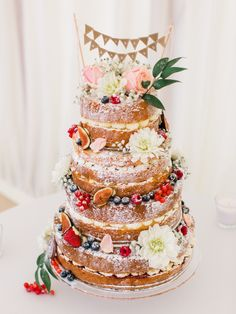 Naked Cake Sponge Layer Fruit Flowers Bunting Whimsical Luxury Summer Garden Party Wedding https://www.wookiephotography.com/