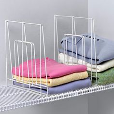 Keep your wire closet shelving nice and organized with the Large White Wire Shelf Divider.  Designed to fit in both standard wire and tight mesh shelving this closet organizer is ideal for keeping stacks of clothing or linens tidy in closets throughout the home.  Although two are pictured here shelf dividers are sold I