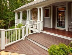 wooden deck front of house -- great step down idea for somebody who has trouble walking.  I'd have made the deck deeper though