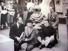 Paul Éluard, Nusch Éluard, Diana Brinton Lee, Salvador Dalí (in diving suit), E.L.T. Mesens (seated on the floor), Rupert Lee  June 11, 1936. The International Surrealist Exhibition opens in New Burlington Galleries, London.