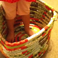 I must figure out to make this toy basket!  Its strips of fabric with rope inside sewn into a circle...  Found a step by step tutorial to make a fabric cord basket: http://www.craftstylish.com/item/33825/how-to-sew-a-fabric-bowl/page/all